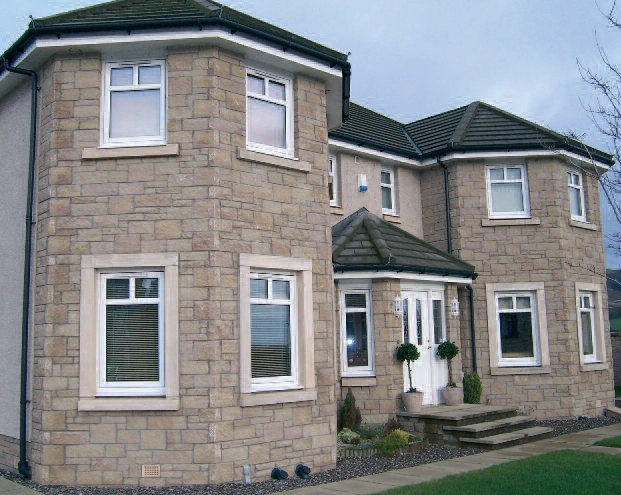 House built with Bekstone Brown Buff Reconstituted Tumbled Stone Walling
