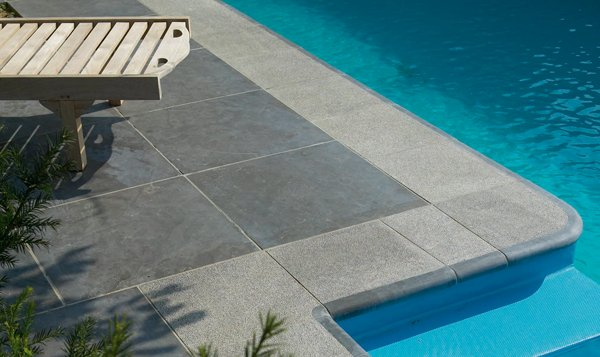 Pool copings pavestone natural paving stone for for Natural stone around pool